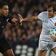 Alexis Palisson, France beats off the challenge of Ma'a Nonu, New Zealand, during the New Zealand V France Final at the IRB Rugby World Cup tournament, Eden Park, Auckland, New Zealand. 23rd October 2011. Photo Tim Clayton...