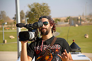 Video camera man with camera on shoulder