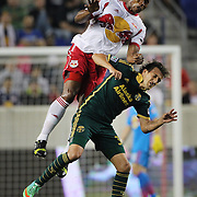 Jámison Olave, (left), New York Red Bulls, wins a header as he is fouled by Maximiliano Urruti, Portland Timbers during the New York Red Bulls Vs Portland Timbers, Major League Soccer regular season match at Red Bull Arena, Harrison, New Jersey. USA. 24th May 2014. Photo Tim Clayton