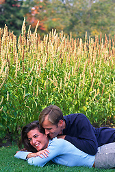 couple being playful in a grassy area