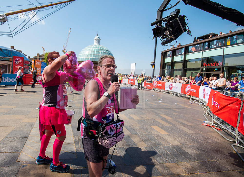 © Licensed to London News Pictures. 22/04/2018. London, UK. Two runners rally the crowd with a song at the Cutty Sark in Greenwich during the Virgin Money London Marathon 2018. Photo credit: Rob Pinney/LNP