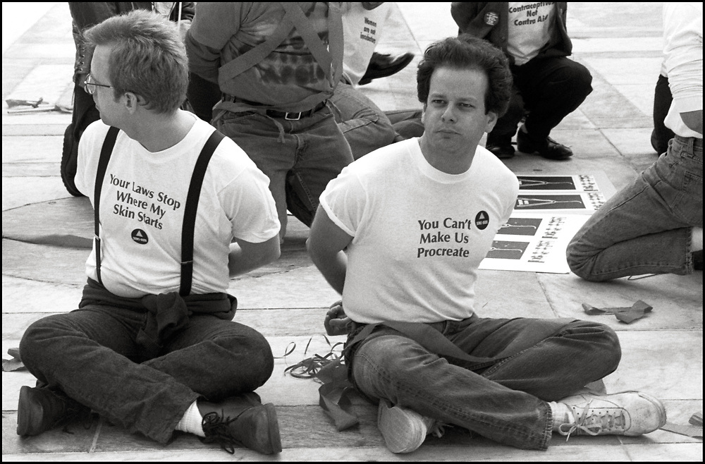 Steve Quester(R) of ACT UP NY and Wham! was arrested, on April 26, 1989, when abortion rights opponents, backed by the Bush Administration, urged the Supreme Court to overturn Roe v. Wade in Webster v. Reproductive Health Services. Pro-choice activists clashed with opponents outside the court, with more than two dozen demonstrators were arrested. <br /> <br /> In Webster v. Reproductive Health Services, the Court upheld several provisions of a Missouri law that regulated the performance of abortions.   The Court refused to invalidate the law's preamble stating that life begins at conception.