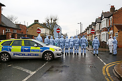 © Licensed to London News Pictures. 09/04/2019. London, UK. Crime scene investigators carries out the search on Church Road, Manor Park, East London where a man in his 20s was shot and stabbed to death on Monday 8 April 2019. Police were called around 9.30pm and the man was was found with knife and gunshot wounds. The victim was pronounced dead at the scene. Photo credit: Dinendra Haria/LNP