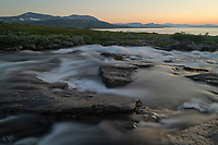 Summer sunset over river flowing into lake Virihaure at Staloluokta along Padjelantaleden Trail, Padjelanta national park, Lapland, Sweden