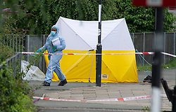 © Licensed to London News Pictures 30/07/2021. Greenwich, UK. Second crime scene,  Thames path crime scene. A police investigation has been launched after a double stabbing in Greenwich, London which has left one man dead and another in a life-threating condition in hospital. A large cordon is in place with police forensic officers working two crime scenes near the Cutty Sark. Photo credit:Grant Falvey/LNP