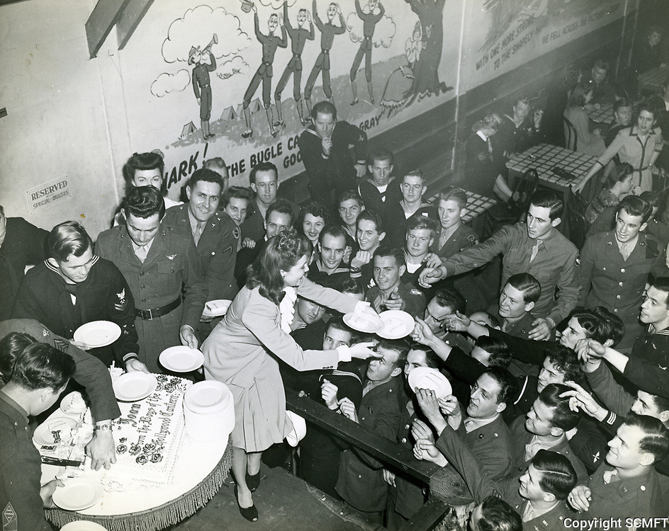 1944 Joan Leslie hands out slices of her birthday cake at the Hollywood Canteen