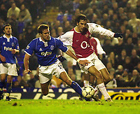 Photo. Glyn Thomas.<br /> Birmingham City v Arsenal. Barclaycard Premiership<br /> St Andrew's Stadium, Birmingham. 22/11/03.<br /> Arsenal's Robert Pires (R) scores Arsenal's third goal while Matthew Upson is unable to stop him.