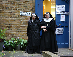 Nuns from Tyburn Convent leave a polling station at St John's Parish Hall, central London, after casting their votes in the General Election.