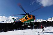 Italy, Madonna di Campiglio, Gino BRESADOLA welcome the military corp Guardia di Finanza helicopter at his refuge