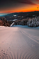 Untouched ski slope at sunrise