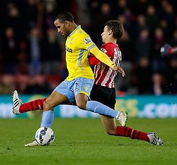 Jason Puncheon of Crystal Palace is tackled by Filip Djuricic of Southampton - Photo mandatory by-line: Rogan Thomson/JMP - 07966 386802 - 03/03/2015 - SPORT - FOOTBALL - Southampton, England - St Mary's Stadium - Southampton v Crystal Palace - Barclays Premier League.