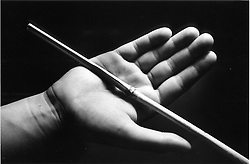 Closeup of young person's open hand being caned,