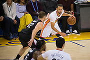 Golden State Warriors guard Stephen Curry (30) handles the ball against LA Clippers forward Blake Griffin (32) at Oracle Arena in Oakland, Calif., on January 28, 2017. (Stan Olszewski/Special to S.F. Examiner)