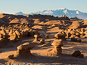 Mount Ellen, at the northern end of the Henry Mountains, rises prominently to the south of Goblin Valley State Park. Admire fanciful hoodoos, mushroom shapes, and rock pinnacles in Goblin Valley State Park, in Emery County between the towns of Green River and Hanksville, in central Utah, USA. The Goblin rocks eroded from Entrada Sandstone, which is comprised of alternating layers of sandstone (cross-bedded by former tides), siltstone, and shale debris which were eroded from former highlands and redeposited in beds on a former tidal flat.