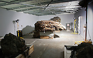 A mass formed of molten matter from 4 floors of the World Trade Center, one of the Artifacts chosen by curators out of the wreckage  from the World trade Center temporarily stored within an 80,000 square foot hanger at JFK airport, Hanger 17. Some of the artifacts will be in the National September 11 Memorial Museum set to open in 2012.  F-0007 refered to as a compression is an artifact of4 floors of the towers compressed in the space of 2 ft. of fused material.