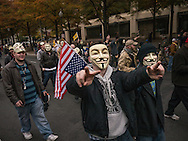 """5 November, 2013, Washington, DC. Masked supporters of """"Anonymous"""" marched from the White House to the U.S. capitol."""