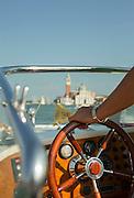 Water taxi on the Canale della Giudecca towards the Island of San Giorgio Maggiore. Venice, Italy, Europe