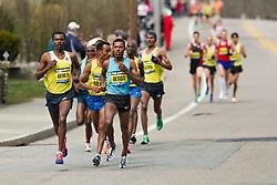 2013 Boston Marathon: lead group of elite men surge, led by Lelisa Desisa