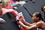 Shelayna Oskan-Clarke (GBR) signs an autograph for a young fan after winning the Bronze medal in the Women's 800m Final in a personal best time of 1.59.81 during the final session of the IAAF World Indoor Championships at Arena Birmingham in Birmingham, United Kingdom on Saturday, Mar 2, 2018. (Steve Flynn/Image of Sport)