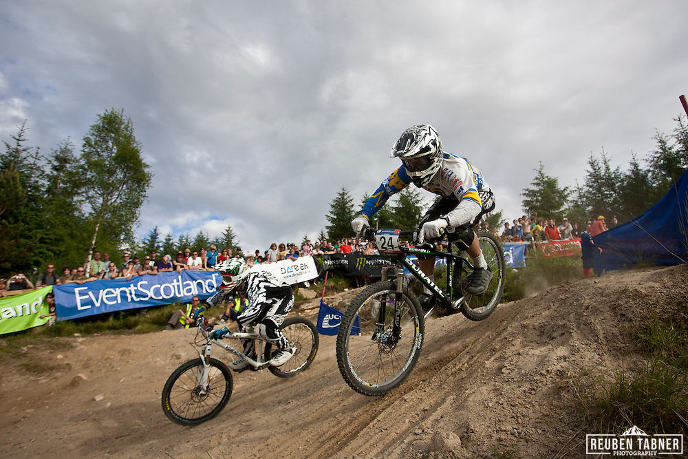 Petr Muhlhans (24) (CZE) and Petrik Bruckner (25) (GER) battle it out in the 1/8 finals on the Four Cross (4X) course at the UCI Mountain Bike World Cup in Fort William, Scotland.