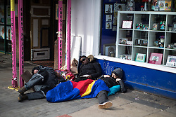 April 3, 2017 - Manchester, Greater Manchester, UK - Manchester , UK . Three people lie slumped in the middle of the day outside a shop on Piccadilly , in Manchester City Centre . The city has experienced a growth in the number of people sleeping rough and emergency services report spikes in the need to tend to people high on Spice  (Credit Image: © Joel Goodman/London News Pictures via ZUMA Wire)