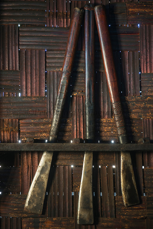 Ao Naga knives on wall<br /> Ao Naga headhunting Tribe<br /> Mokokchung district<br /> Nagaland,  ne India