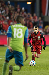 December 9, 2017 - Toronto, Ontario, Canada - Toronto FC forward SEBASTIAN GIOVINCO (10) dribbles the ball while defended by Seattle Sounders defender KELVIN LEERDAM (18) during the MLS Cup championship match at BMO Field in Toronto, Canada.  Toronto FC defeats Seattle Sounders 2 to 0. (Credit Image: © Mark Smith via ZUMA Wire)