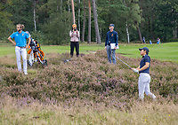 HILVERSUM - Netherlands vs Italy (1-2) . Dutch Jerry Ji plays his ball the heather. with a referee. Quarter finals. ELTK Golf 2020 The Dutch Golf Federation (NGF), The European Golf Federation (EGA) and the Hilversumsche Golf Club will organize Team European Championships for men. left Gregorio de Leo (It) COPYRIGHT KOEN SUYK