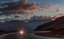 THEMENBILD - ein Motorradfahrer am Abend. Die Grossglockner Hochalpenstrasse verbindet die beiden Bundeslaender Salzburg und Kaernten mit einer Laenge von 48 Kilometer und ist als Erlebnisstrasse vorrangig von touristischer Bedeutung, aufgenommen am 13. September 2016, Heiligenblut, Oesterreich // a motorcyclist evening. The Grossglockner High Alpine Road connects the two provinces of Salzburg and Carinthia with a length of 48 km and is as an adventure road priority of tourist interest at Heiligenblut, Austria on 2016/09/13. EXPA Pictures © 2016, PhotoCredit: EXPA/ JFK