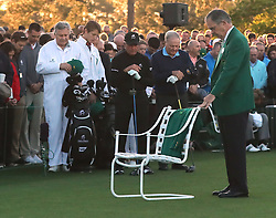 April 6, 2017 - Augusta, Georgia, USA - Augusta National Chairman Billy Payne leads a moment of silence for Arnold Palmer, his green jacket placed in his empty chair, before Gary Player and Jack Nicklaus tee off during the honorary start of the Masters at Augusta National Golf Club. (Credit Image: © Curtis Compton/TNS via ZUMA Wire)