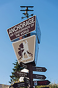 Sign showing distances to other cities at the Visit Anchorage Log Cabin Visitor Information Center at Peratrovich Park in downtown Anchorage, Alaska.