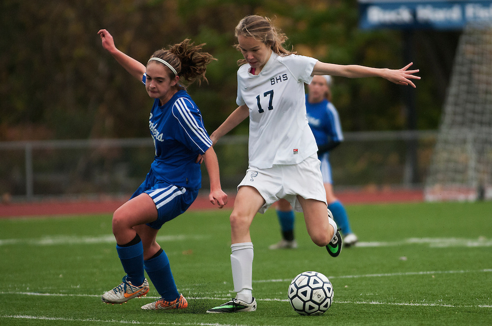 Burlington's Fiona Dunn (17) and Burlington's Maggie Kirby (21) battle for the ball during the girls playoff soccer game between the U-32 Raiders and the Burlington Sea Horses at Buck Hard Field on Friday afternoon October 24, 2014 in Burlington, Vermont (BRIAN JENKINS, for the Free Press)