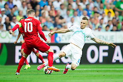 Wayne Rooney of England vs Jasmin Kurtic of Slovenia during the EURO 2016 Qualifier Group E match between Slovenia and England at SRC Stozice on June 14, 2015 in Ljubljana, Slovenia. Photo by Vid Ponikvar / Sportida