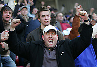 Photo:  Frances Leader.<br /> Charlton v Leicester. FA cup fifth round. <br /> The Valley<br /> 19/02/2005<br /> Leicester fans celebrate their teams win agianst Charlton.