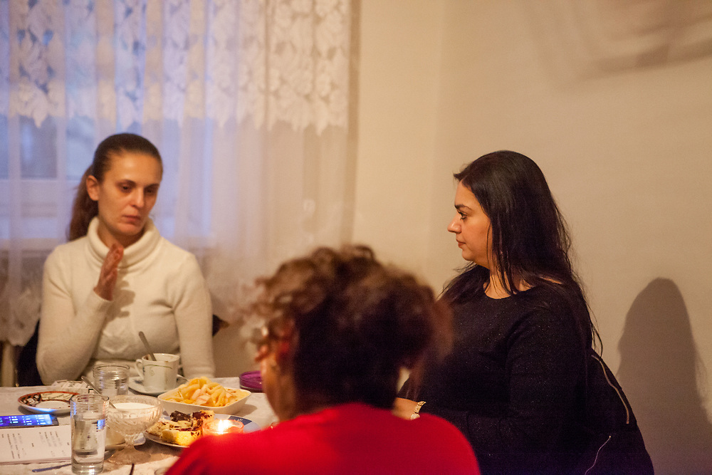 Volunteer and Roma activist Jolana Smarhovycova (right) listening to Andrea Danova (26) about her experiences during the enrolment of her son Richard (6) at a mainstream school in Ostrava. During a meeting with volunteers and mothers with their children for consultation and data collection regarding school enrolments in Ostrava. The meeting was in a volunteers flat.