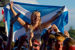 Raising the Saltire in the evening sunshine at T in the Park, Strathallan Castle, Auchterarder, 8th July 2016, <br /> (c) Brian Anderson | Edinburgh Elite media