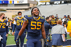 """Oct 3, 2020; Morgantown, West Virginia, USA; West Virginia Mountaineers defensive lineman Dante Stills (55) sings """"Country Roads"""" after defeating the Baylor Bears at Mountaineer Field at Milan Puskar Stadium. Mandatory Credit: Ben Queen-USA TODAY Sports"""