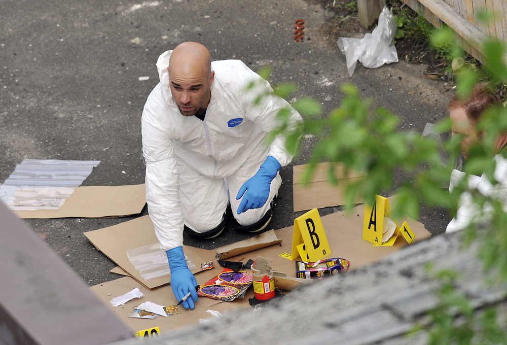 FBI search an alley on the property of a house where Faisal Shahzad lived, in Bridgeport, Conn., Tuesday, May 4, 2010.  Shahzad was taken into custody late Monday by FBI agents and New York Police Department detectives while trying to leave the country.  (AP Photo/Jessica Hill)