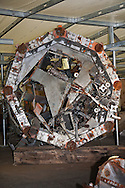 Part of the antena tower that was on top of the World trade Center is one of the artifacts chosen by curators out of the wreckage  from the World Trade Center  stored temporarily gwithin an 80,000 square foot hanger at JFK airport. Some of the artifacts will be in the National September 11 memorial Museum set to open in 2012.