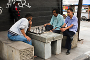 Men play chess on the sidewalk in Bandung city, Indonesia