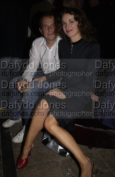 David and Louise Grob, Bob Carlos Clarke exhibition opening at the Eyestorm Gallery after-party at Noble Rot. 2 November 2004. ONE TIME USE ONLY - DO NOT ARCHIVE  © Copyright Photograph by Dafydd Jones 66 Stockwell Park Rd. London SW9 0DA Tel 020 7733 0108 www.dafjones.com