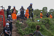 Dozens of XR activists are protesting the occupation of their workshop property from HS2 Limited construction workers in Colne Valley, London, Tuesday, May 12, 2020. (Photo/ Vudi Xhymshiti)