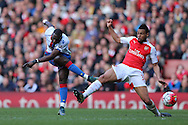 Yannick Bolasie of Crystal Palace shoots and scores his sides 1st goal to make it 1-1.Barclays Premier league match, Arsenal v Crystal Palace at the Emirates Stadium in London on Sunday 17th April 2016.<br /> pic by John Patrick Fletcher, Andrew Orchard sports photography.