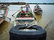 22 NOVEMBER 2017 - YANGON, MYANMAR: A river taxi comes into a pier on the Twante Canal in Yangon. The small boats shuttle passengers across the canal or up and down the canal to other piers in Yangon.    PHOTO BY JACK KURTZ