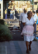 Masaya townspeople walk past the burned and charred body of a Nicaragua National Guardsman after house to house street fighting in Civil War in Nicaragua - 1978.