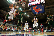 DALLAS, TX - JANUARY 15: Nick Russell #12 of the SMU Mustangs drives to the basket against the South Florida Bulls on January 15, 2014 at Moody Coliseum in Dallas, Texas.  (Photo by Cooper Neill/Getty Images) *** Local Caption *** Nick Russell