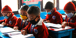 Nepalese school students cover their faces with masks as preventive measure against swine flu in Kathmandu, capital of Nepal, on March 1, 2015. At least six people have been affected by Swine Flu virus with influenza A and B called (H1N1) in Nepalese Capital Kathmandu, doctors said here on Feb. 23. EXPA Pictures © 2015, PhotoCredit: EXPA/ Photoshot/ Sunil Sharma<br /> <br /> *****ATTENTION - for AUT, SLO, CRO, SRB, BIH, MAZ only*****