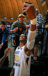 Nov 24, 2018; Morgantown, WV, USA; West Virginia Mountaineers forward Sagaba Konate (50) takes a selfie with a fan after beating the Valparaiso Crusaders at WVU Coliseum. Mandatory Credit: Ben Queen-USA TODAY Sports
