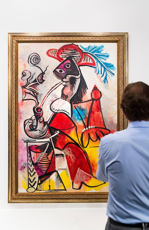 Man views a Picasso painting at Art Basel Miami Beach 2015