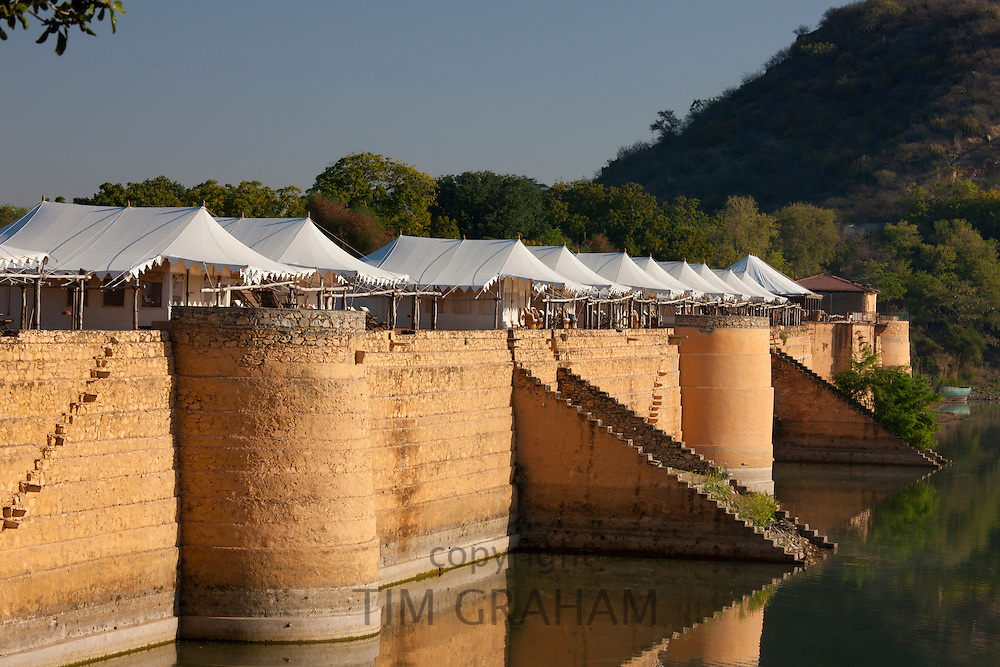 Chhatra Sagar reservoir and luxury tented camp oasis in the desert at Nimaj, Rajasthan, Northern India